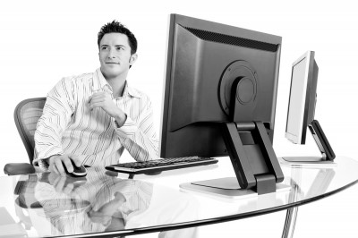 Handome IT professional at stylish business desk made by commercial photographer Derek Smith