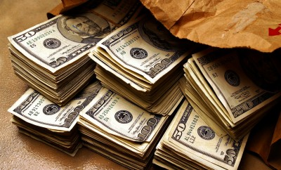 stacks of money in brown paper bag for financial marketing and advertising
