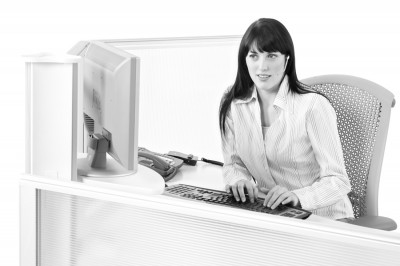 black and white picture of beautiful model working at high tech customer support computer