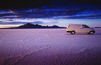 Professional photograph of White delivery van on Bonneville Salt Flats with dramatic light for software marketing campaign