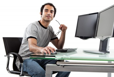 professional photography of computer security expert working at styish desk
