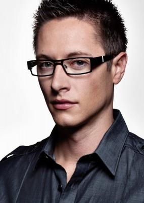 dramatic headshot of handsome young man wearing fashion eyewear by Salt Lake Advertising photographer Derek Smith