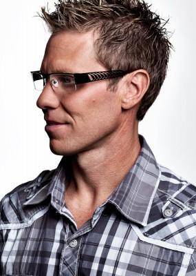 dramatic headshot of rugged looking man wearing fashion eyewear by Salt Lake Advertising photographer Derek Smith