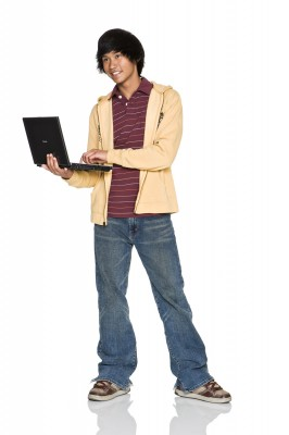 Handsome teenage asian boy with laptop computer on white