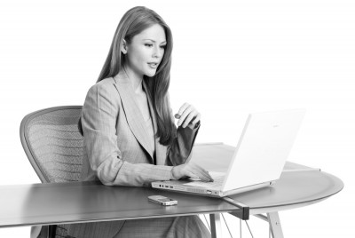 Photo of attractive business woman at desk with laptop computer made by Utah photographer Derek Smith