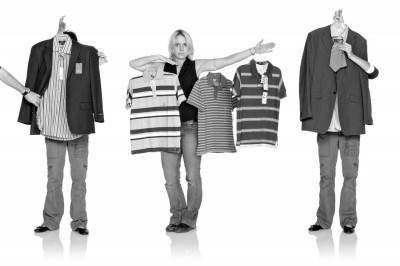 black and white test photograph of wardrobe stylists with clothes shot in commercial studio on white