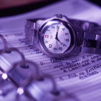 Studio photography of mans watch on day planner for marketing