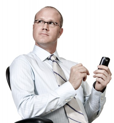 funny photograph of office nerd using smart phone