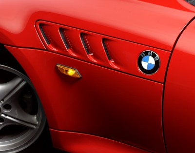 close up of red BMW sportscar photographed in the studio