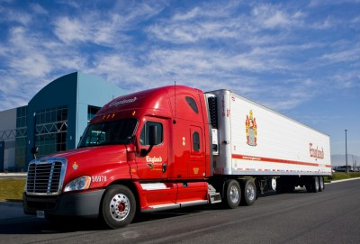 Red semi truck with white trailer for industrial advertising and transportation