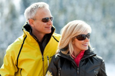 Handsome couple wearing ski fashions and sun glasses shot on location at Deer Valley resort in Utah