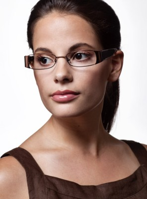 headshot of dark haired beauty wearing fashion eyewear with nice lips and soft focus for advertising