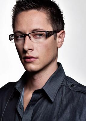 studio photograph of handsome young man wearing fashion eyewear by Salt Lake Advertising photographer Derek Smith