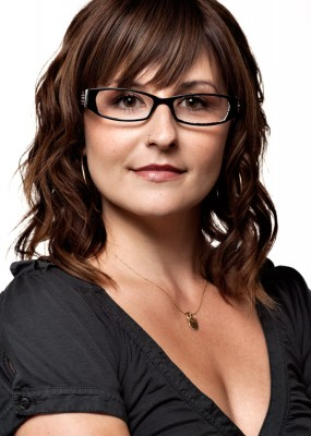 Fashion photograph of beautiful young woman wearing glasses in the studio